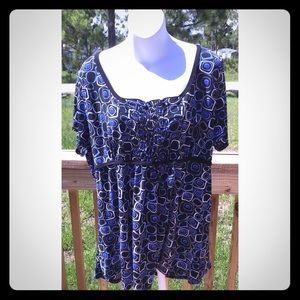 Only 9 Size 3X Stretchy Tunic with an Empire Waist